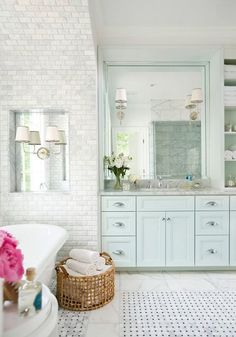 Mark Williams Design - bathrooms - marble subway tile, marble tile, sloped ceiling, angled ceiling, woven basket, woven towel basket, marble...