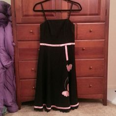 Black dress with pink butterfly detail Worn once or twice. Bought to wear to homecoming. Still in perfect condition! Cute dress for a special occasion. byer too! Dresses