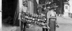 An Australian NCO checks a batch of bread before it is transferred to the bread store at an Australian Field Bakery in Rouen, France, September 1918.
