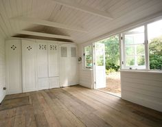 Pretty little shed interior. Fill it up with plants and gardening tools