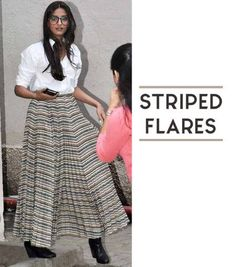 Geek Goddess. Sonam's big nerdy glasses make her look insanely attractive! This is a perfect look for a working fashionista. The stripes beautifully compliment the white of the shirt to create a very smart yet peppy look. https://www.estrolo.com/whatstrending/cat/celeb-style/  #sonamkapoor #shirt #skirt #glasses #geek #Celebstyle #NewYearStyles #NewYearFashions #BollywoodFashion