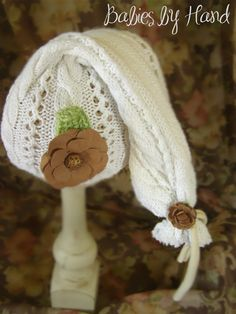 Newborn Upcycled Winter White Long Knotted Elf Hat, Newborn Baby Girl Elf Hat Photo Prop Hat, Baby Girl Upcycled Hat, Long Knotted Elf Hat. $20.00, via Etsy.