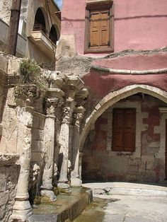 Windows overlooking an old fountain, Rethymno, Crete by winninator, via Flickr
