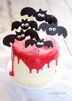 This Vampire Bat Cake is a red velvet cake with a red ganache. The bats are made from melted chocolate. Make this cake for your Halloween party!
