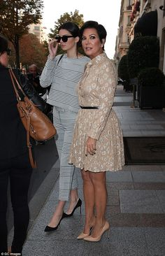 Family time: The stunning model was joined by mother Kris Jenner for the outing...