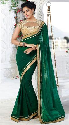 Dark green art silk designer saree with golden embroidered blouse