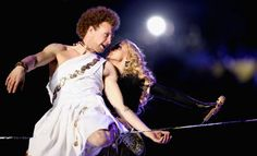 Who Was That Guy in the Toga With Madonna? And What Was He Doing?