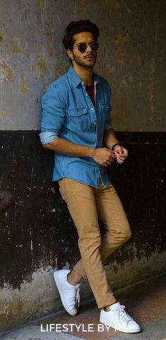 Handsome male model wearing a blue denim shirt and brown chinos styles urbains, blue shirt Indian Men Fashion, Mens Fashion Blog, Fashion Blogger Style, Suit Fashion, Trendy Fashion, Men Fashion Casual, Fashion Ideas, Fashion Menswear, Fashion Outfits