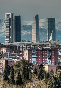 The 4 Towers with the Guadarrama Mountains as a backdrop. Madrid, Spain