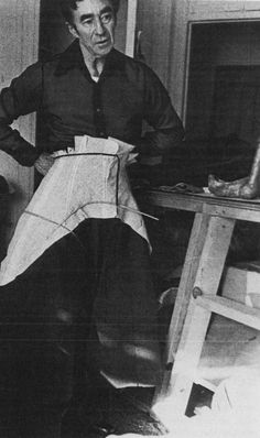 Charles James at work, trying on a dress skirt in progress.