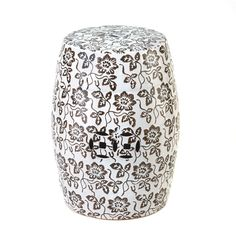"""Bohemian Chic White Floral Design Stool.The floral pattern on this stool is a beautiful way to add some graphic drama to your home. It can be used as a stool table or as a standalone decorative accent. Move it to the garden or patio for outdoor use!    Maximum weight limit is 220 lbs. Item weight: 15 lbs.  13 3/8"""" x 13 3/8"""" x 18"""" high.  Ceramic."""