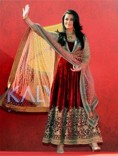 Bollywood beauty queen Aishwarya Rai Bachchan looked royal in a red velvet Sabyasaachi anarkali with gold embroidered sleeves and dupatta as...