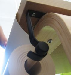 awesome idea! curtain rod, and wooden dowel to hold paper roll, mounted under play room table! genius.
