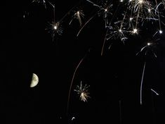 Astrophoto: Fireworks and the Quarter Moon