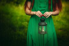Woman holding lantern with candle by Daria Zuykova on 500px