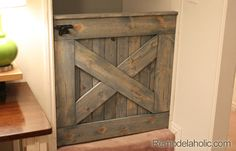DIY Barn Door Baby Gate. SOOO much more attractive than the store-bought variety!  -  Brought to you by NBC's American Dream Builders, Hosted by Nate Berkus