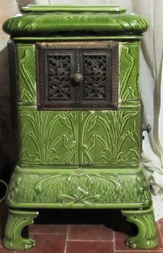 the green cottage .. X ღɱɧღ ||19th century  ceramic tile stove by Christabellee