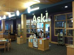 Love this giant ASK! sign. Super-easy to see for a public who pretty much does not read typical signage. Westwood (MA) Public Library (children's library)