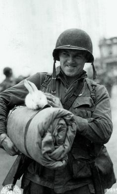 Corp. Michael Deliman,Returns From France With Rabbit Mascot, England, 1944