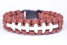 Saw a lot of interest in the football-bracelet design from yesterday, so found this awesome tutorial!! Check out BoredParacord's new video for a football-themed bracelet! https://www.youtube.com/watch?v=8Q24hDkiJAI&list=UUWhKFUSIbtGK1CANZjwTgsA