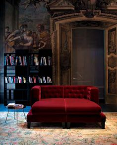 Although I don't care for the book case, the table or the rug ... this red sofa and the opulent doorway is something I would love to have one day.