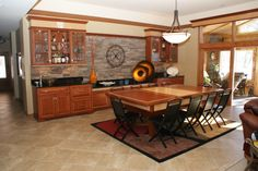 Custom Made Dining Table Conceals A Pool Table In This Mixed Use Space From  Signature Homes