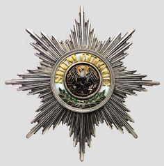 """Medal of the Order of the Black Eagle, with the motto """"SUUM CUIQUE"""" in the center."""