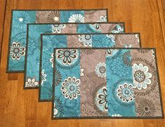 This is a made to order listing - Ready to ship in about 10 days (usually sooner). Quilted teal and gray place mats featuring medallions with graduating shades of teal and gray with matching dark gray border. The backing fabric is a teal and gray medallion print from the same
