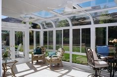 Sunroom... A much needed room in a sun deprived country.. I can just vedge there on a sunny wintry day given that the floors are heated.. and there's a fireplace..