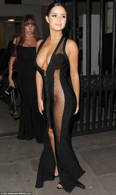 Flash of skin: The dress zipped right down her middle, from the plunging neckline to a centre-split