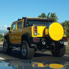 This hummer H2 SUT is huge!  #protecautocare #engineflush #hummer #h2 #sut #yellow #custom #customized #carrepair #lifted #big #tires #huge #rims  #nofilter #followus