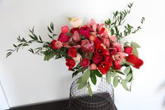 Garden roses, lilies, tulips, ranunculus, protea and Italian rusckus