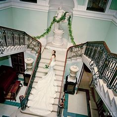 Plum Sykes on the staircase of her second cousin Sir Tatton Sykes's house Sledmere in Yorkshire, England, before her wedding to Toby Rowland in 2005. Alexander McQueen designed her dress.    Photo: Jonathan Becker, Vogue (January 2006)