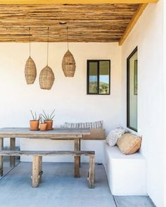 Home tour a mediterranean and southwest-inspired joshua tree abode - sunset - sunset magazine Rustic Dining Benches, Outdoor Dining, Outdoor Spaces, Adobe Fireplace, Large Baths, Desert Homes, Interior Photography, Back Patio, Renting A House