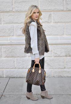 fur vest and leather pants.