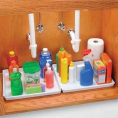 Under-sink protector trays. I put them in the bathroom and the kitchen. One small leak can damage the cabinet and flooring beyond repair, and the trays also catch spills from cleaning products. These are just a good idea!