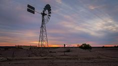 The windmill is an iconic sight throughout Outback Australia and much loved by photographers and artists. #australia #outback #windmill #sunset