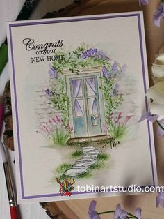 Create a watercolor spring door using Art Impressions watercolor stamps and markers. This would be a perfect card for someone who is moving to a new house.