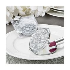 This is a silver crystal bling compact mirror.  Embellished with tiny clear crystals on the lid, front clasp opening and dual sided mirrors. Gorgeous for carrying in your clutch or handbag.  Get it now at Jazz Fashion and Accessories.com