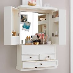 Empty wall space becomes get-ready space with our Hannah Beauty Wall Cabinet. It features two drawers for beauty supplies, a beveled mirror and additional storage on the inside of each door. Bedroom Furniture, Bedroom Decor, Bedroom Ideas, Bedroom Styles, Furniture For Small Bedrooms, Furniture Design, Small Bedroom Storage, Teen Room Decor, Modern Bedroom