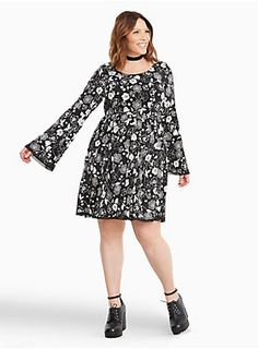 "This feminine black challis skater dress turns it down with a white floral print. The fabric feels like a silky substitute with a stretchy waistband that turns up the comfort level. The bell sleeves add volume, with a tie cutout back lending a final sexy touch.<div><br></div><div><b>Model is 5'9.5"", size 1 <br></b><div><ul><li style=""list-style-position: inside !important; list-style-type: disc !important"">Size 1 measures 40"" from shoulder</li><li style=""list-style-position:..."