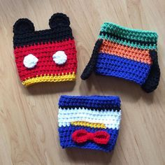 A few cozies I made for a silent auction. by crochetedrunner Crochet Coffee Cozy, Crochet Cozy, Crochet Beanie, Crochet Gifts, Coffee Cup Cozy, Tea Cozy, Disney Crochet Patterns, Crochet Disney, Crochet Ideas