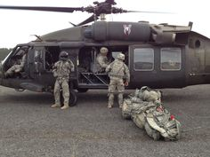 Troops loading to go home in Black Hawk helicopter!
