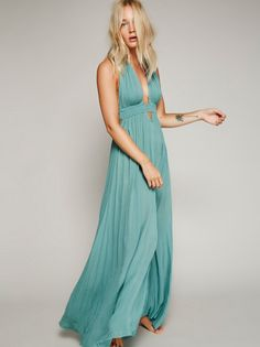 Look Into the Sun Maxi   Sun goddess maxi in a crinkly crepe with a deep V-neck, adjustable rope halter, and stretchy smocked empire waist with geo cutout detailing below. Raw edges. We love tying the slit, and creating a knotted hem to change up the look.