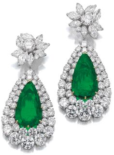 Very attractive pair of emerald and diamond pendent ear clips, Van Cleef & Arpels, circa 1970.  Via Sotheby's.