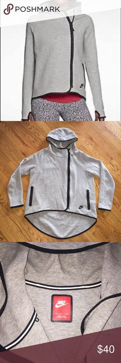 ❄️Nike Tech Fleece Cape Hoodie Nike Tech Fleece Cape Hoodie in grey with black accents. Worn only a handful of times. Assymetrical zipper, longer coat tail back covers your behind. Flattering, cozy and stylish! There is one tiny bleach mark by right pocket (4th picture), hard to even find because it looks like part of the heathered grey material. Wanted to make sure and point it out, however small.  Otherwise, like new condition! Nike Tops Sweatshirts & Hoodies