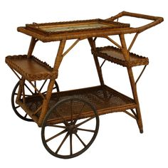 Early 20th c. American Wicker Tea Cart | From a unique collection of antique and modern bar carts at https://www.1stdibs.com/furniture/tables/bar-carts/