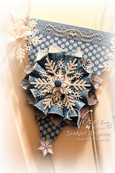 Designed by Sankari Wegman: cute idea make paper flower and put snowflake in the middle!