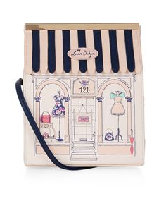Designed to emulate a London boutique, this soft pink novelty across-body bag is adorned with a navy striped roof cover, and printed with a shop front window with mannequins and accessories. Features a magnetic metal frame and a long shoulder strap.