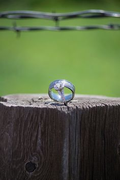 Taken by me. Sky is the Limit Images. Denver, Colorado Photographer. Engagement. Rings. Barbed Wire